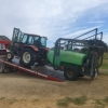 Troy backing tractor and sprayer off the tray